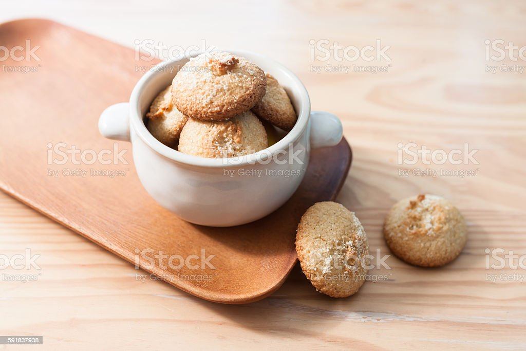 Homemade Amaretti biscuits on wooden table. stock photo