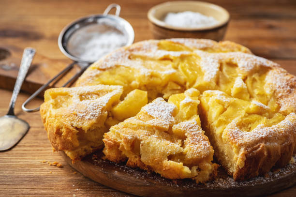 Homemade apple buiscuit pie, on wooden background. stock photo