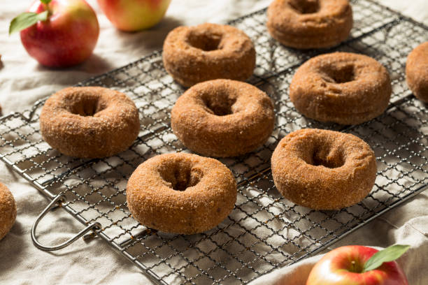 Homemade Apple Cider Donuts Homemade Apple Cider Donuts with Cinnamon Sugar hot apple cider stock pictures, royalty-free photos & images