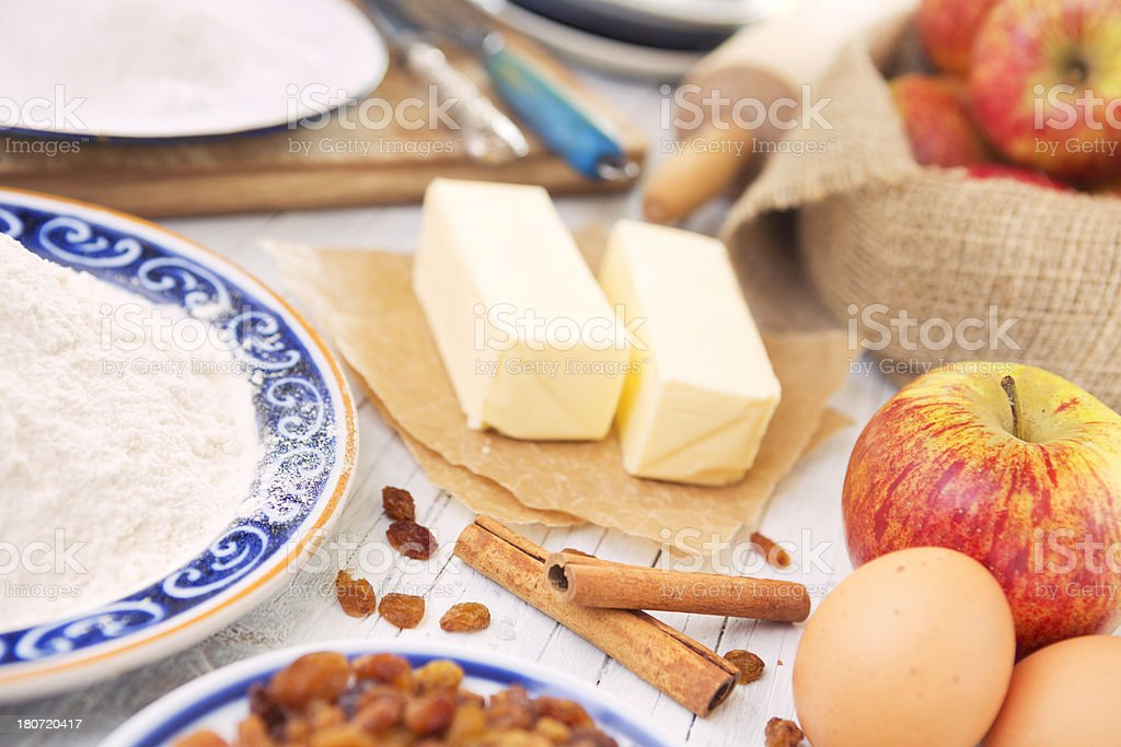Homemade apple pie and ingredients on a rustic table royalty-free stock photo