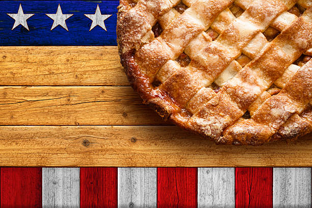 Homemade Apple Pie on Rustic Patriotic Stars and Stripes Table stock photo