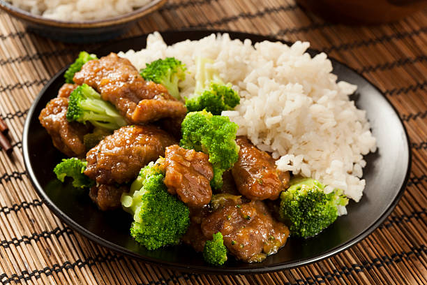 homemade asian beef and broccoli - chinese food stock photos and pictures