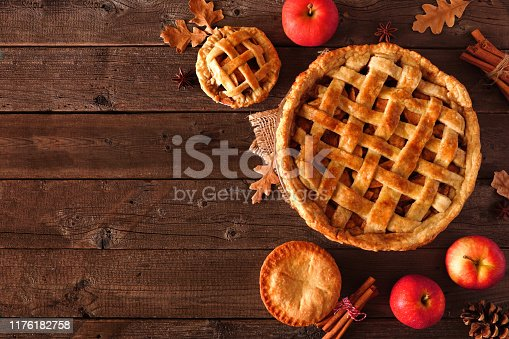 Homemade autumn apple pie corner border. Top view table scene over a rustic wood background with copy space.