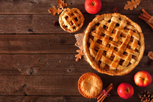 Homemade autumn apple pie, top view corner border over a rustic wood background stock photo