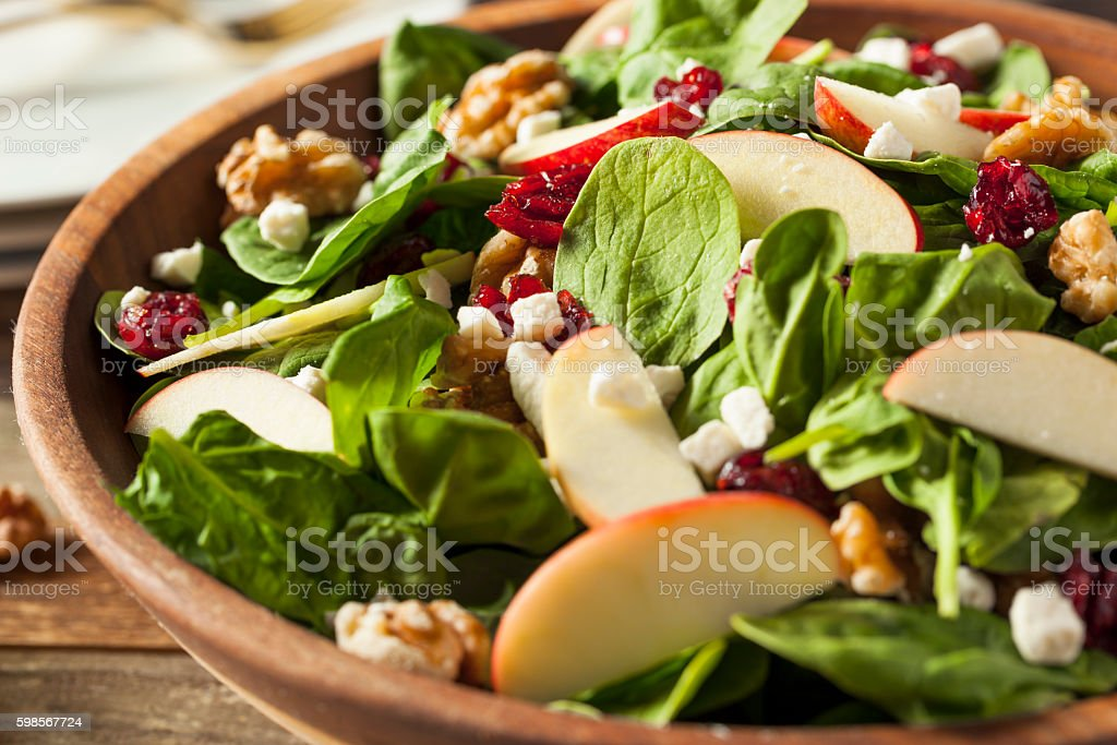 Homemade Autumn Apple Walnut Spinach Salad stock photo