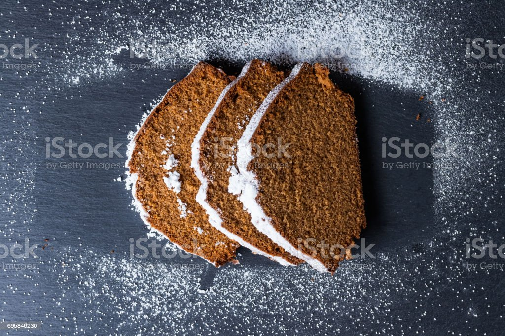 Homemade baked sweet gingerbread slices covered with powdered sugar. stock photo