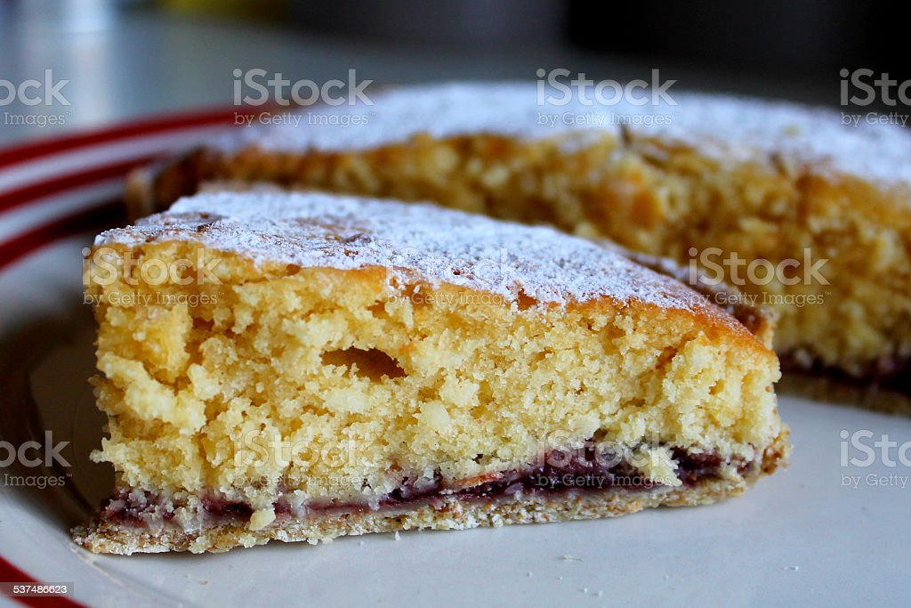 Homemade bakewell type cake - pastry, jam, cake - Slice stock photo