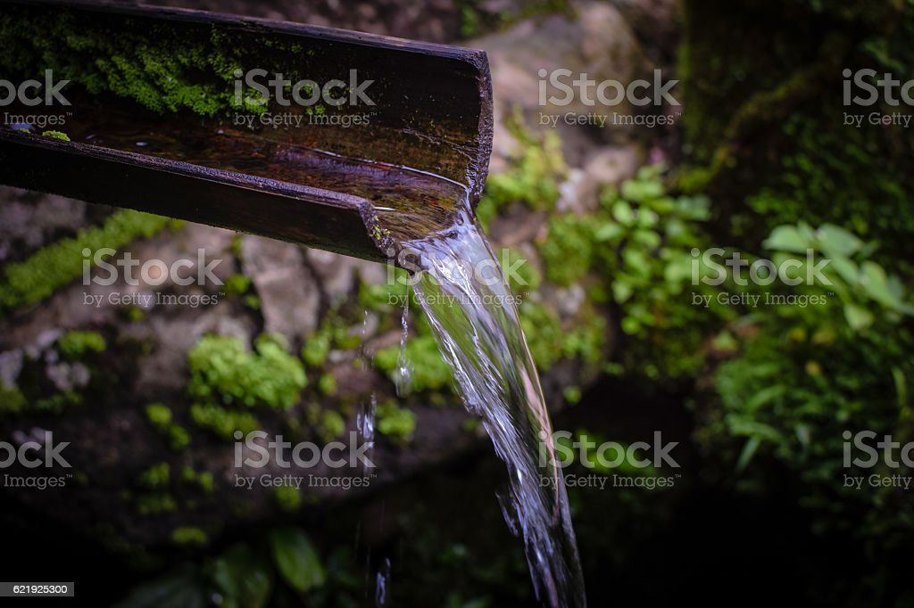 Homemade bamboo waterfall. stock photo