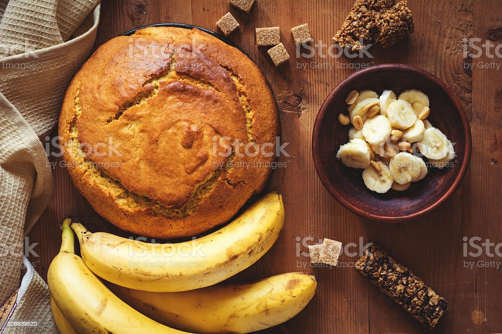 Homemade banana bread with chocolate and peanuts, top view stock photo