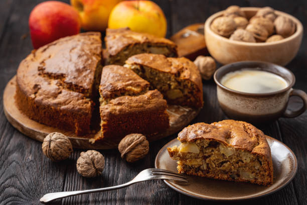 Homemade banana cake with apples and walnuts stock photo