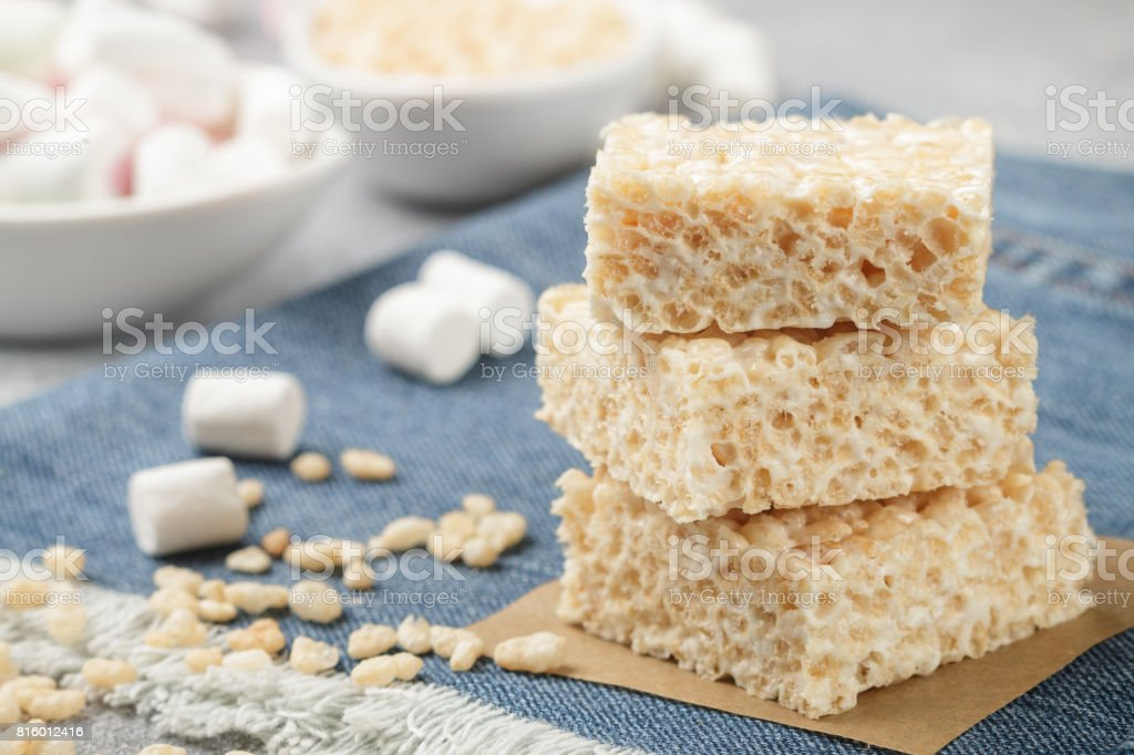 Homemade bars of Marshmallow and crispy rice and ingredients on the table. American dessert. Selective focus