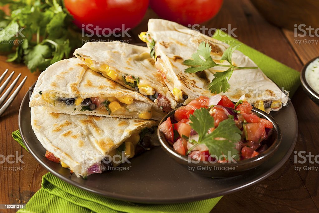 Homemade bean quesadilla with salsa and corn stock photo