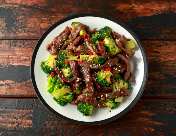 Homemade Beef and Broccoli on wooden table stock photo