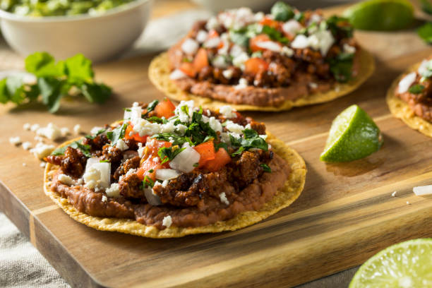 Homemade Beef and Cheese Tostadas Homemade Beef and Cheese Tostadas with Lime and Cilantro main course stock pictures, royalty-free photos & images