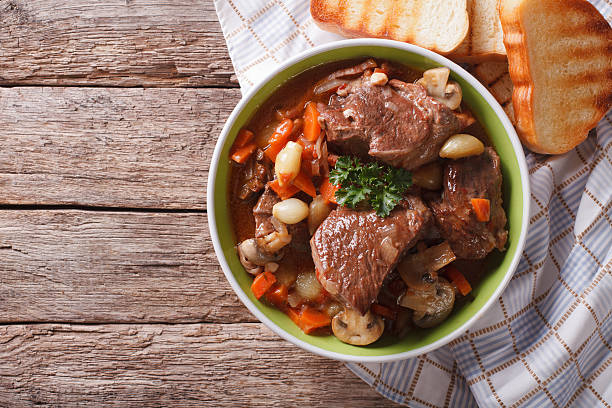 Homemade Beef Bourguignon in a bowl. horizontal top view Homemade Beef Bourguignon in a bowl on the table. horizontal view from above beef stew stock pictures, royalty-free photos & images