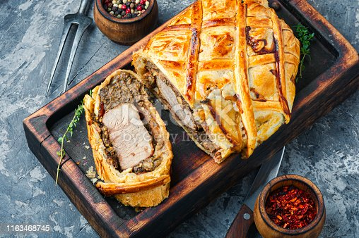 Beef Wellington - beef tenderloin festive dish.English cuisineHomemade beef Wellington.Meat, baked in puff pastry