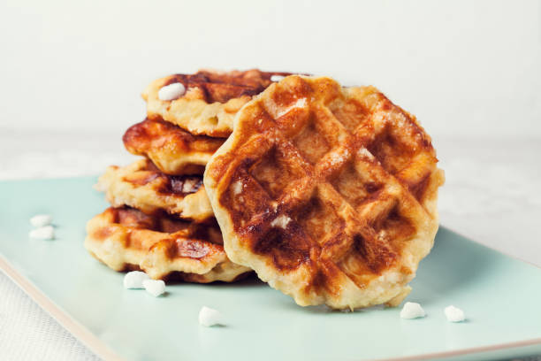 Homemade Belgian Liege or sugar waffles Homemade Belgian Liege or sugar waffles prepared with pearl sugar lulik stock pictures, royalty-free photos & images