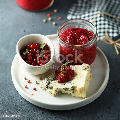Homemade berry chutney with blue cheese