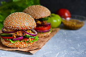 Homemade, big hamburger with meat and fresh vegetables with space for text.