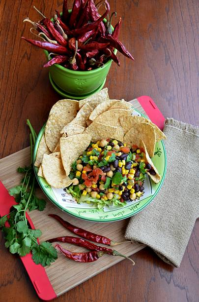 Homemade Black Bean Corn Salsa with Chips stock photo