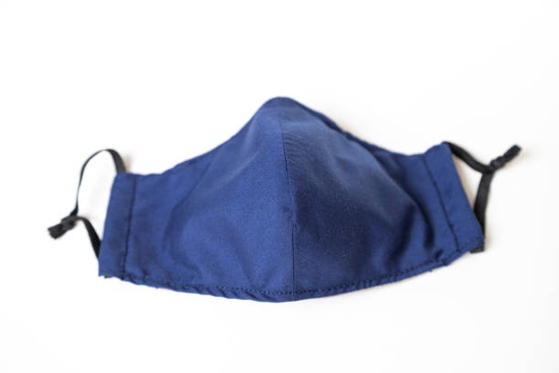 Homemade Blue Cloth Face Mask Isolated on White stock photo