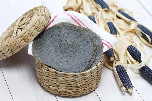 homemade blue corn tortilla - tortilla stock photos and pictures