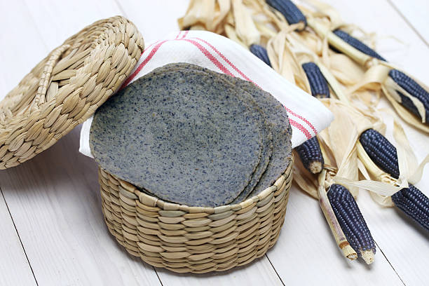 homemade blue corn tortilla - hopi stock photos and pictures