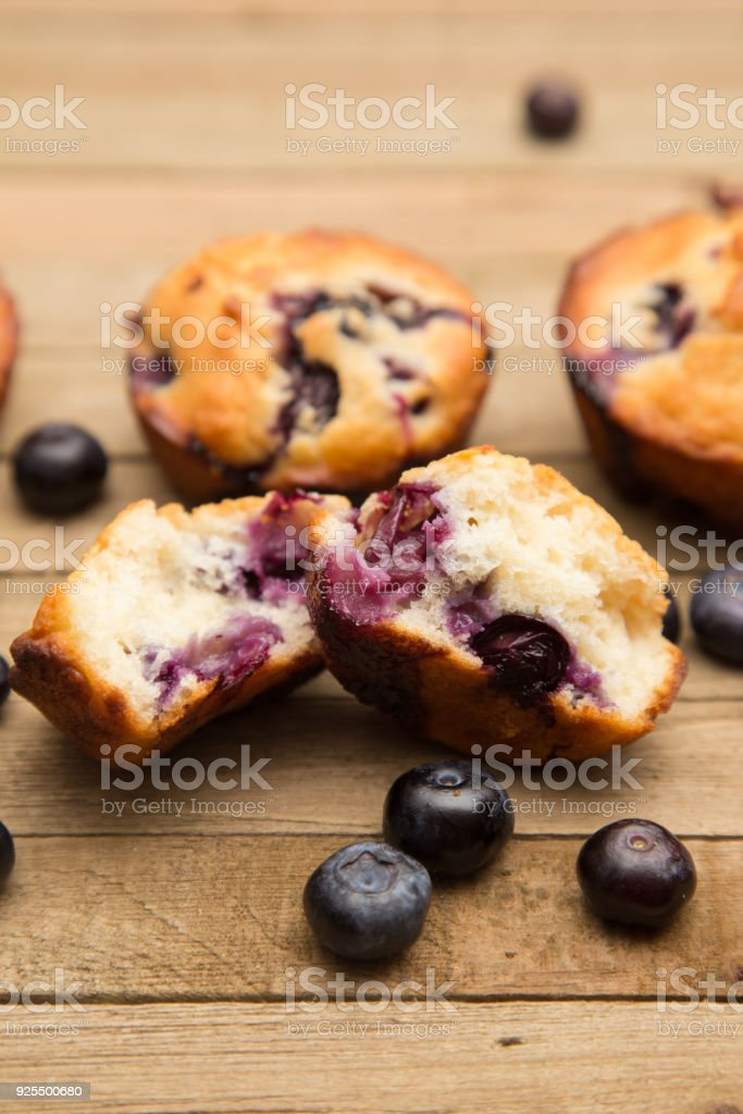 Homemade Blueberry Muffins on a Rustic Wood Table stock photo