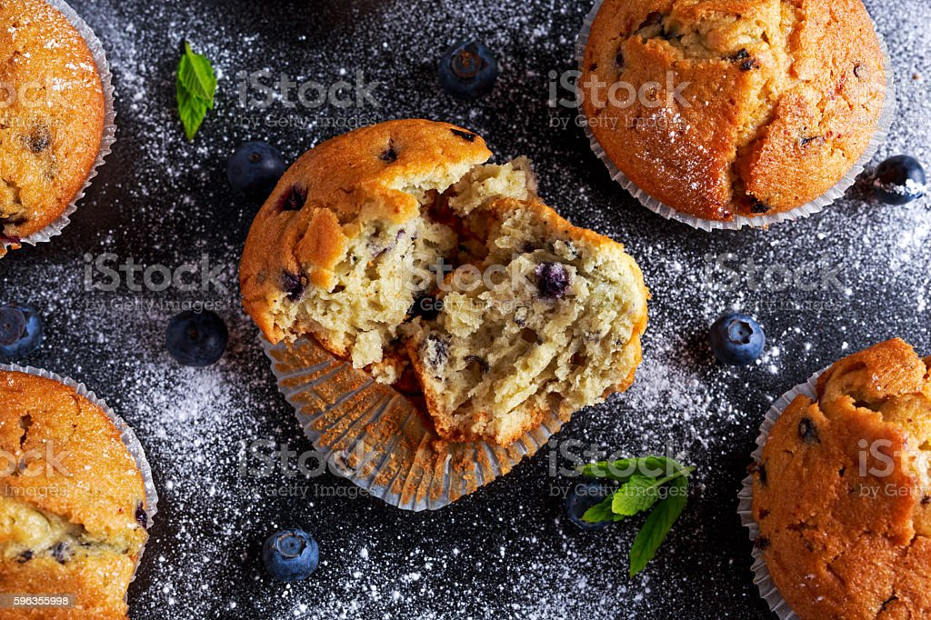 Homemade Blueberry Muffins with powdered sugar, fresh berries. royalty-free stock photo