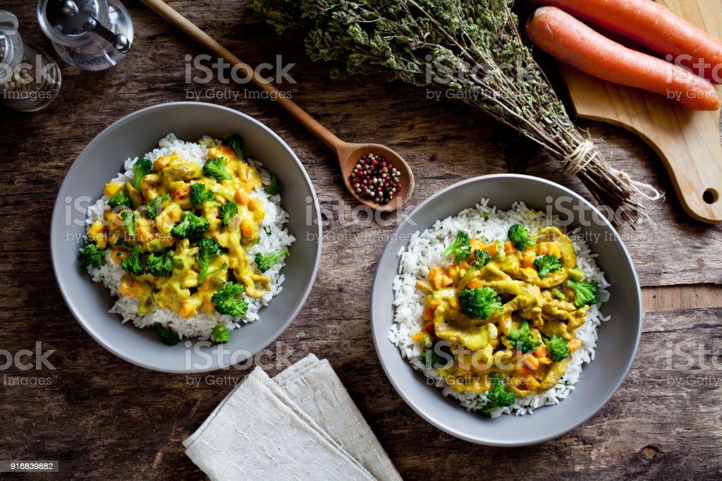 Homemade Bowls Of Pork And Broccoli Stir Fry stock photo