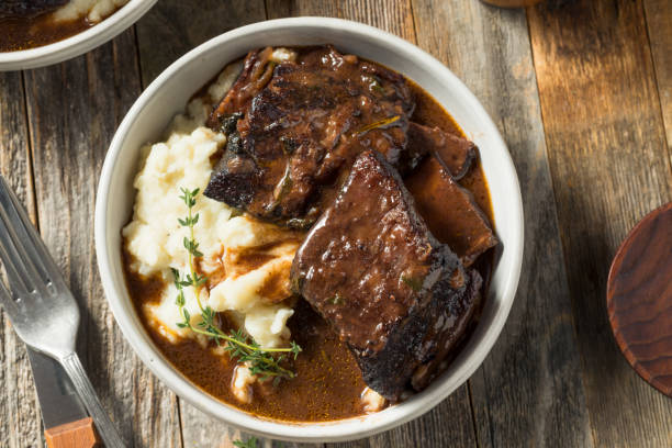homemade braised beef short ribs - braised stock pictures, royalty-free photos & images