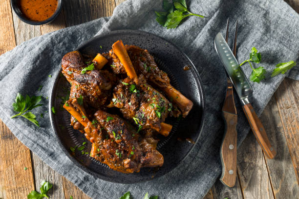 homemade braised lamb shanks - braised stock pictures, royalty-free photos & images