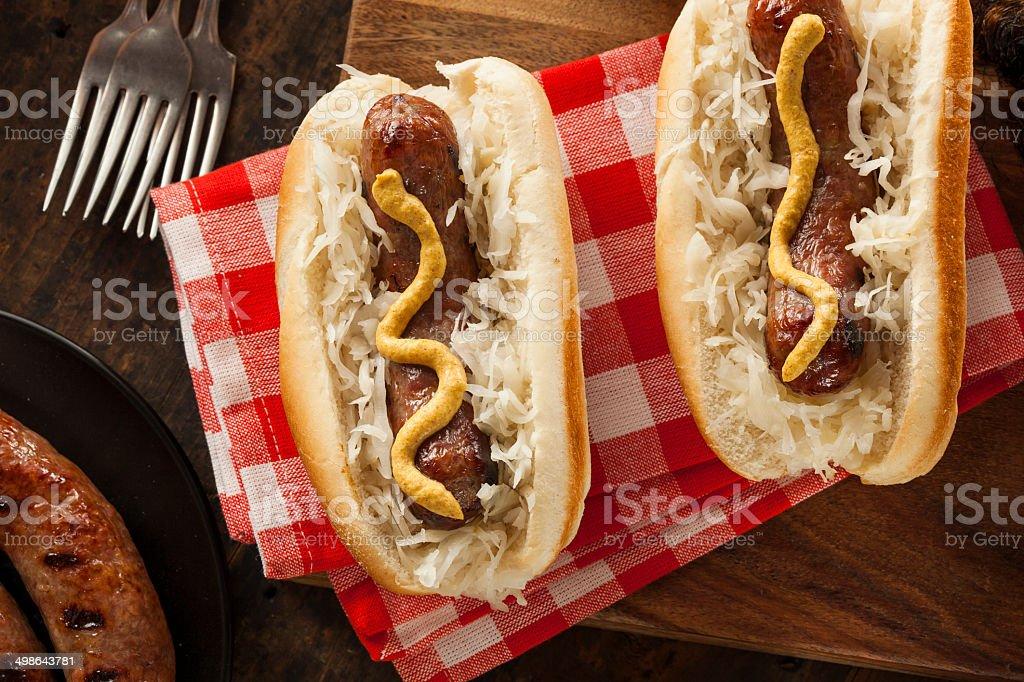 Homemade Bratwurst with Sauerkraut bildbanksfoto