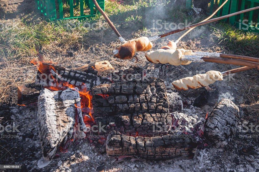 Homemade bread baked over a bonfire stock photo