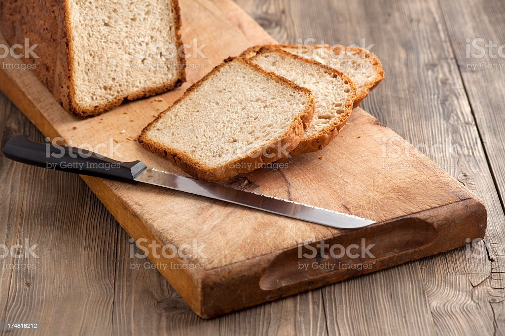 Homemade bread on a chopping board royalty-free stock photo