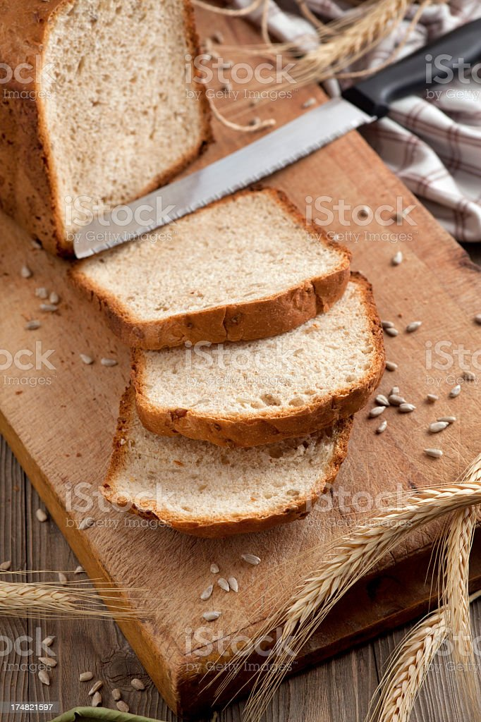 Homemade bread on a chopping board stock photo