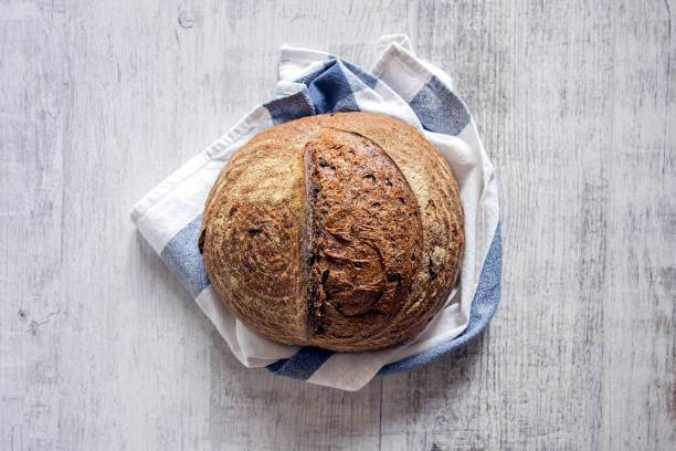 homemade bread fresh baked organic bread on wooden table round loaf stock pictures, royalty-free photos & images