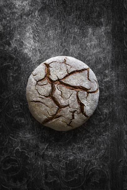 Homemade bread Fresh baked organic bread on dark background round loaf stock pictures, royalty-free photos & images