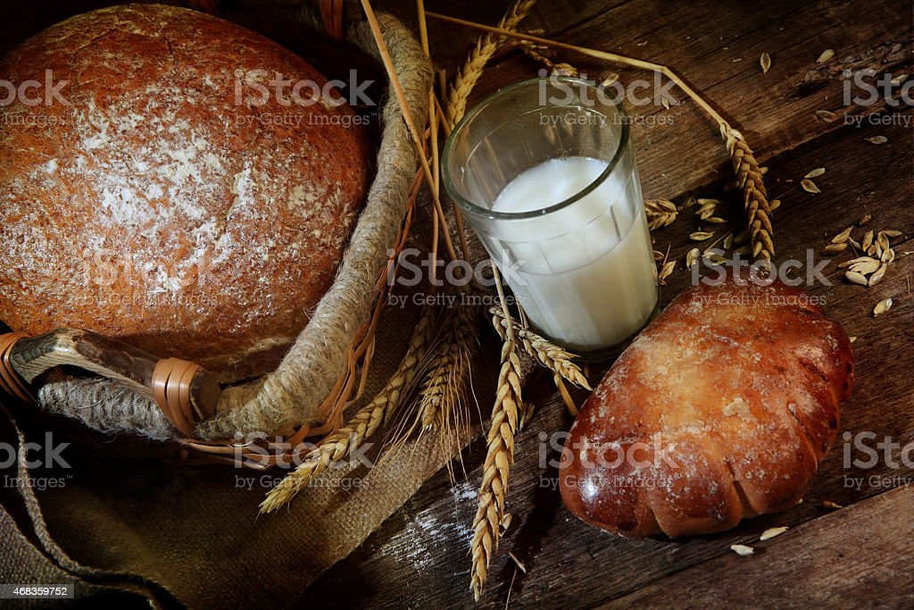Homemade bread with flour, wheat spikelets royalty-free stock photo