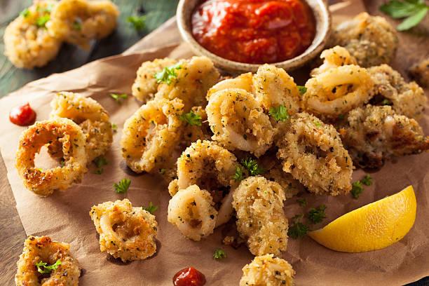 homemade breaded fried calamari - kızartılmış stok fotoğraflar ve resimler