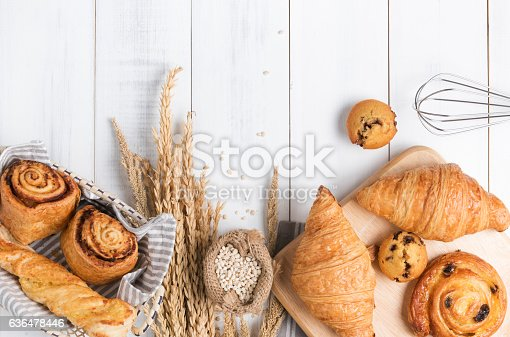 Homemade breads or bun on wood background, croissant puff cinnamon, breakfast food