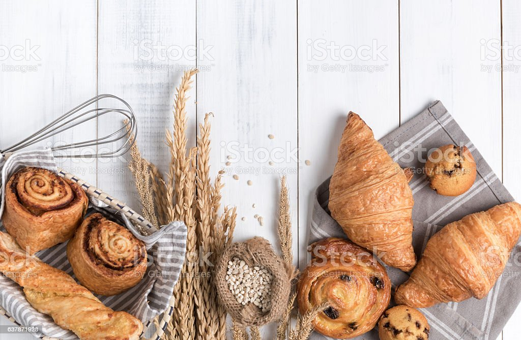 Homemade breads or bun on wood background stock photo