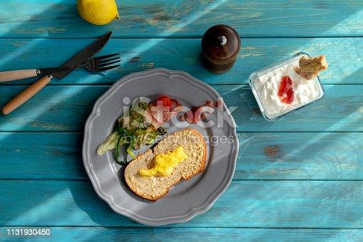 homemade breakfast: baked kitten shape on toast and in yogurt