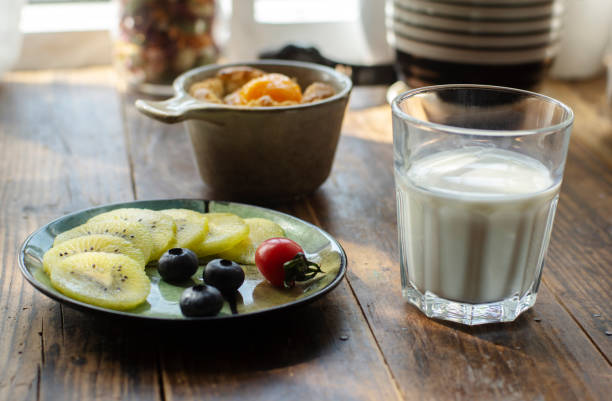 homemade breakfast: fruits, milk and toasted bread cup