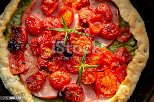 homemade breakfast: pie with tomato, ham and cabbage