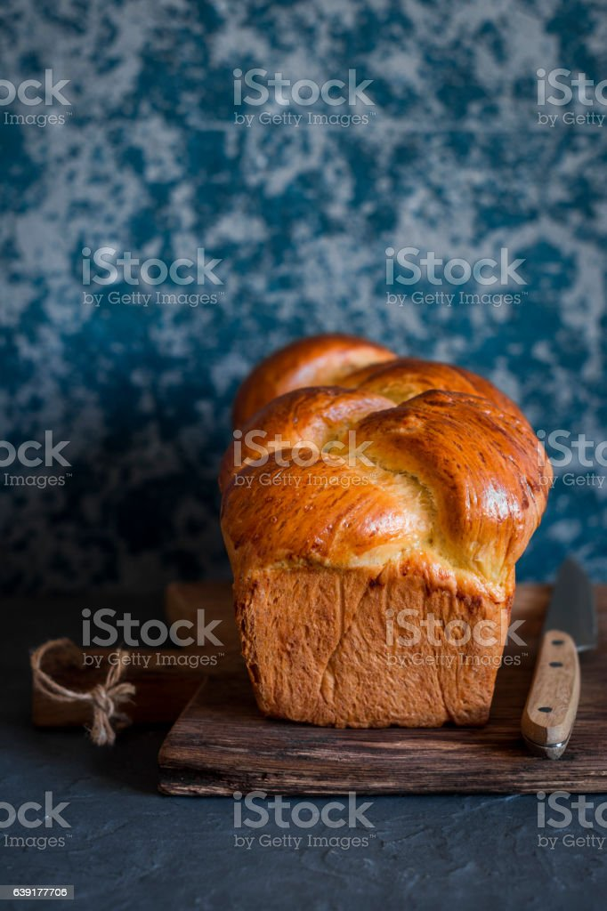 Homemade brioche on a dark background. Front view - Photo