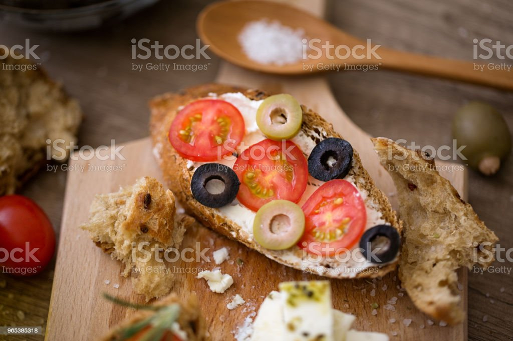 homemade bruschetta on wooden cutting board with vegetables zbiór zdjęć royalty-free