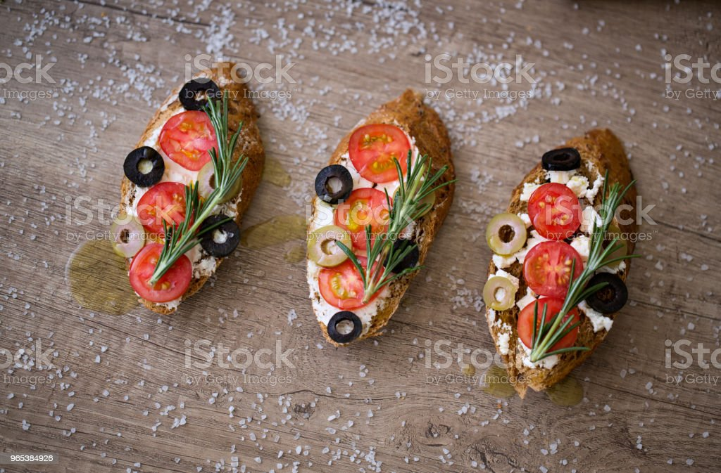 homemade bruschetta on wooden table with vegetables royalty-free stock photo