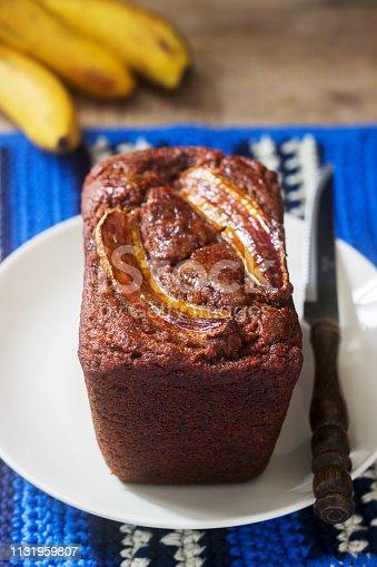 Homemade buckwheat banana cake with honey glaze. Gluten free baking, selective focus.