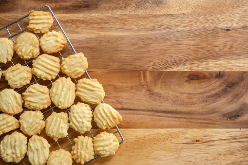 istock Homemade butter cookies on baking rag. Sweet dessert. Top view on wooden background with copy space.  Top view on wooden background with copy space. 1152651842